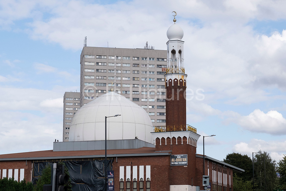 Birmingham Central Mosque stands before social housing tower blocks in Highgate, on 3rd August 2020 in Birmingham, United Kingdom. Birmingham Central Mosque is one of the earliest purpose-built mosques in the UK, and is run by the Birmingham Mosque Trust. The organization, Muslims in Britain classify the Birmingham Central Mosque as, hanafi sunni, and has a capacity of 6,000, including women.