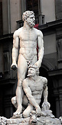 White marble sculpture of Hercules and Cacus by Florentine artist Baccio Bandinelli. Situated in the Piazza della Signoria, Florence, Italy. Circa 1533. Show's demi-god Hercules in a moment of pause after defeating Cacus.
