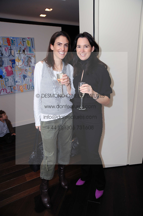 Left to right, ALEX PODELL and SARA TOWNSEND at a private view of Atelier-Mayer.com's collection held at 131 Oakwood Court, London, on 24th November 2009.