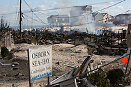 Brick Beach, November 3, 2012, a fire smolders days after it started following Hurricane Sandy. Firemen were unable to reach a fire caused by a gas leak following the storm surge produced by Sandy. <br />  The Jersey shore took the brunt of Hurricane Sandy.