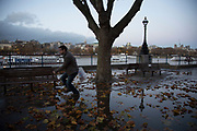 A man after jumping over Autumn leaves in a puddle of rain water on the Southbank riverside walkway, London, United Kingdom. The South Bank is a significant arts and entertainment district, and home to an endless list of activities for Londoners, visitors and tourists alike. (photo by Mike Kemp/In Pictures via Getty Images)