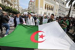 March 26, 2019 - Algiers, Algeria - Algerian students demonstrate with national flags in the center of the capital, Algiers in Algeria on March 26, 2019, against the extension of the mandate of President Abdelaziz Bouteflika and demanding an immediate change. (Credit Image: © Billal Bensalem/NurPhoto via ZUMA Press)