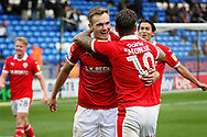 Barnsley midfielder George Moncur (10)  and Barnsley midfielder Ryan Hedges (7) celebrate after the fourth Barnsley goal  the EFL Sky Bet League 1 match between Peterborough United and Barnsley at The Abax Stadium, Peterborough, England on 6 October 2018.