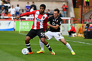 Reuben Reid (33) of Exeter City battles for possession with Neal Eardley (23) of Lincoln City during the EFL Sky Bet League 2 match between Exeter City and Lincoln City at St James' Park, Exeter, England on 19 August 2017. Photo by Graham Hunt.