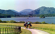 A Killarney jaunting car taking some tourists to view the famous Killarney lakes near Muckross House, Killarney.<br /> Picture by Don MacMonagle.<br /> attnn... Aisling Bray