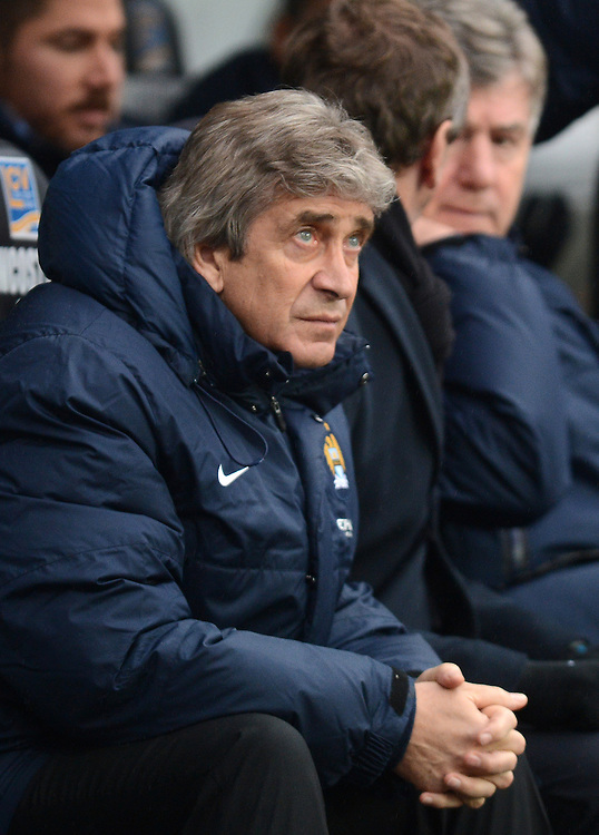 Manchester City's Manager Manuel Pellegrini prior to kick off <br /> <br /> Photo by Ian Cook/CameraSport<br /> <br /> Football - Barclays Premiership - Swansea City v Manchester City - Wednesday 1st January 2014 - Liberty Stadium - Swansea<br /> <br /> © CameraSport - 43 Linden Ave. Countesthorpe. Leicester. England. LE8 5PG - Tel: +44 (0) 116 277 4147 - admin@camerasport.com - www.camerasport.com