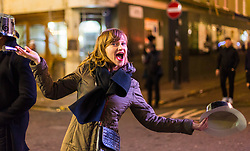 London, January 01 2018. A woman poses for the camera in Soho as revellers in London's West End enjoy New Year's Eve. © SWNS
