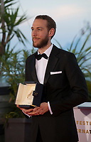 Vasilis Kekatos winner the Best Short Film award for the film The Distance Between Us and The Sky at the Palme D'Or Award photo call at the 72nd Cannes Film Festival, Saturday 25th May 2019, Cannes, France. Photo credit: Doreen Kennedy