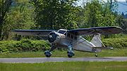 1934 Stinson Reliant SR-5E taking off.