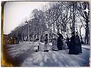 women group with child promenading in public park France Paris 1900s