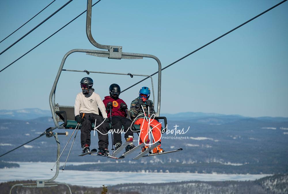 Skiing and riding at Gunstock Mountain.   ©2021 Karen Bobotas Photographer
