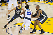 Golden State Warriors guard Stephen Curry (30) and Golden State Warriors forward David West (3) defend Dallas Mavericks guard Wesley Matthews (23) at Oracle Arena in Oakland, California, on February 8, 2018. (Stan Olszewski/Special to S.F. Examiner)