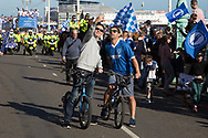 Fans stop for a selfie during the Brighton & Hove Albion Football Club Promotion Parade at Brighton Seafront, Brighton, East Sussex. United Kingdom on 14 May 2017. Photo by Ellie Hoad.