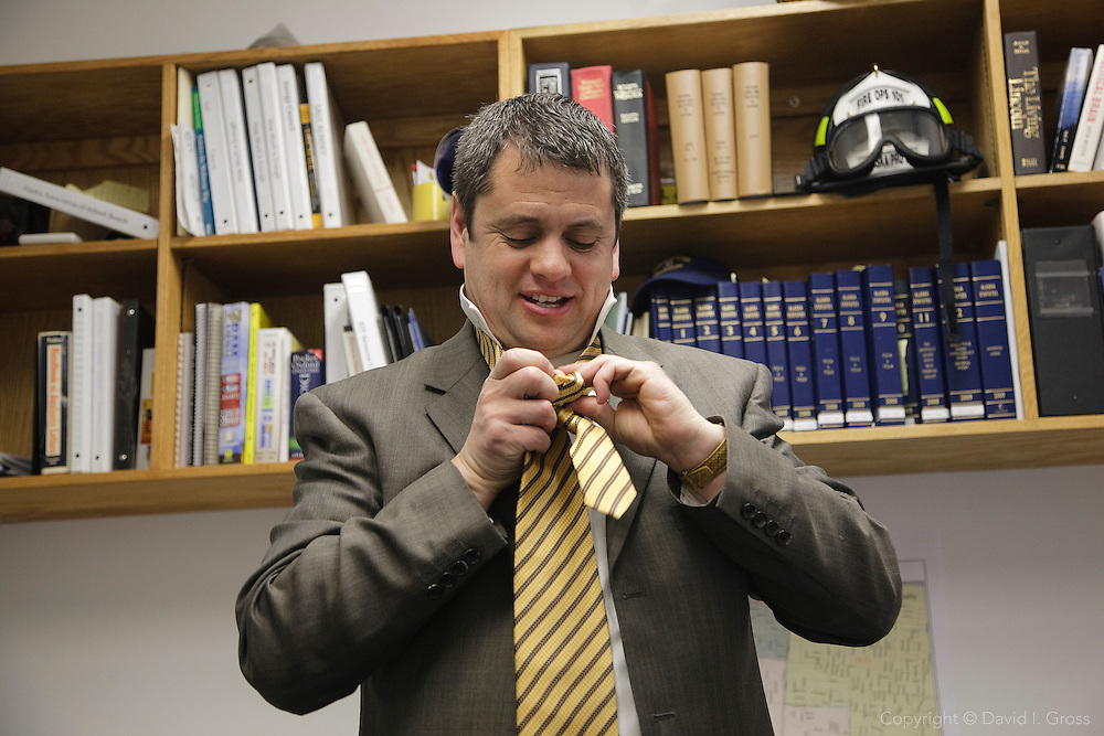 Alaska Representative Chris Tuck (D) changes into his suit in his office at the state capital.