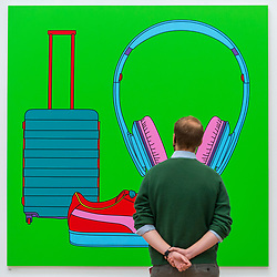 "© Licensed to London News Pictures. 28/09/2020. LONDON, UK. A staff member poses with ""Untitled (With Suitcase)"" by Sir Michael-Craig-Martin (RA).  Preview of the Summer Exhibition at the Royal Academy of Arts in Piccadilly which, due to the Covid-19 lockdown, is taking place for the first time in the autumn.  Over 1000 works in a range of media by Royal Academicians, established and emerging artists, feature in the exhibition which runs from 6 October 2020 – 3 January 2021.  Photo credit: Stephen Chung/LNP"