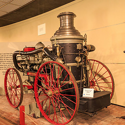 A horse-pulled firefighting pumper is on display at the Pennsylvania State Museum in Harrisburg.