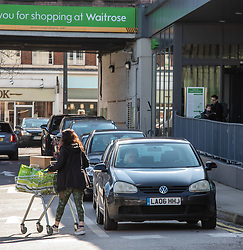 © Licensed to London News Pictures. 06/03/2020. London, UK. A shoppers stocks up on household items at a Waitrose. Queues of cars form at a Waitrose car park in South West London as increased buying continues to hit some of the big supermarkets after a second hospital patient is feared to have succumbed to the Coronavirus disease. Photo credit: Alex Lentati/LNP