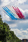 The Red and Blue Arrows fly over Buckingham Palace and Horse Guards in Pall Mall Street, as British Prime Minister Boris Johnson meets with French President Emmanuel Macron in London, Thursday, June 18, 2020. The President of the French Republic visits London to celebrate the 80th anniversary of General de Gaulle's 'Appel' to the French population to resist the German occupation of France during WWII. This is Emmanuel Macron's first foreign trip since lockdown is lifted with caution in both France and Britain, this visit also aims to cement Franco-UK ties at a strained time due to Brexit. (Photo/ Vudi Xhymshiti)