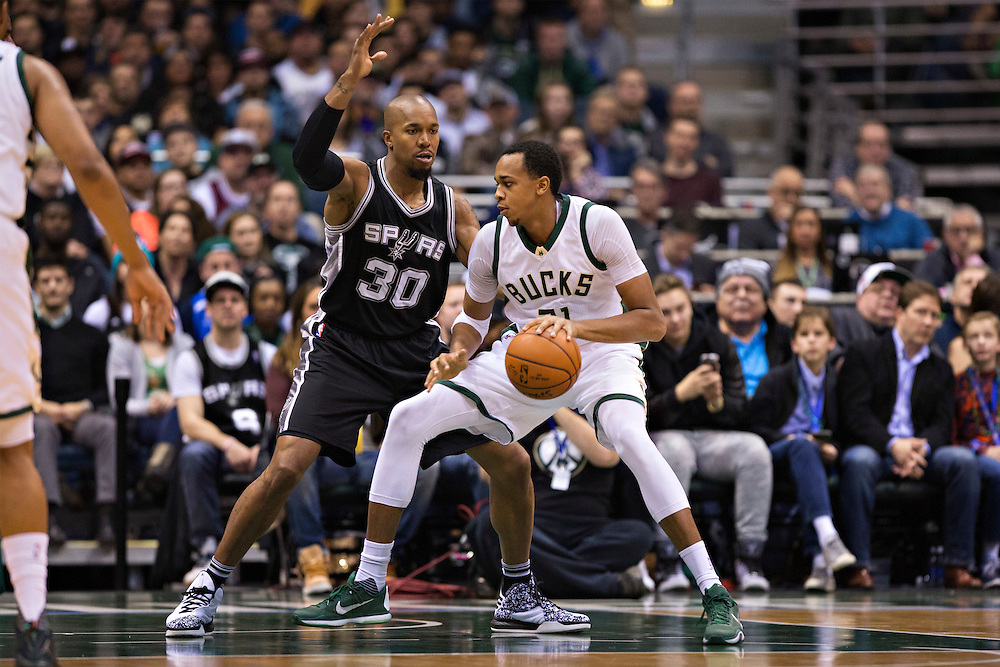 """MILWAUKEE, WI- JANUARY 4:  John Henson #31 of the Milwaukee Bucks backs his way to the basket while being defended by David West #30 of the San Antonio Spurs at BMO Harris Bradley Center on January 4, 2016 in Milwaukee, Wisconsin.  """"NOTE TO USER: User expressly acknowledges and agrees that, by downloading and or using this photograph, User is consenting to the terms and conditions of the Getty Images License Agreement.""""(Photo by Wesley Hitt/Getty Images) *** Local Caption *** John Henson; David West"""