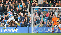 QPR's Matt Smith (left) scores his side's second goal of the game during the Sky Bet Championship match at Loftus Road, London.