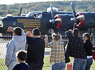 Montgomery, New York -  People watch a B-24 Liberator bomber from Collings Foundation getting ready to take off as part of the Wings of Freedom Tour at Orange County Airport on Oct. 2, 2010.