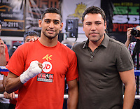 Dec 11,2012.  Montebello CA. USA.  Amir Khan(L) poses with Oscar De La Hoya during  media day Tuesday afternoon at the Ponce De Leon Boxing Club.  Amir Khan will be fighting Carlos Molina this Saturday night at the Los Angeles Sports Arena live on ShowTime. .Photo By Gene Blevins/LA Daily News
