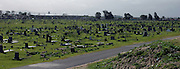 The Guguletu cemetery, just off Guguletu township of Cape Town, is a place where many people who died because of HIV/AIDS have been buried. South Africa is also claiming to have no land left for the dead and many people are in fact buried on top of others.