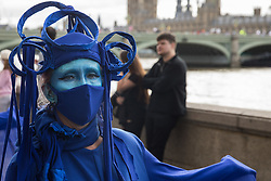 London, UK. 6th September, 2020. The blue rebels pass along the South Bank with fellow climate activists from the Ocean Rebellion and Extinction Rebellion during a colourful Marine Extinction March. The activists, who are attending a series of September Rebellion protests around the UK, are demanding environmental protections for the oceans and calling for an end to global governmental inaction to save the seas.