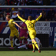 Aaron Schoenfeld, (left), Columbus Crew, scores the first of his two goals during the New York Red Bulls Vs Columbus Crew, Major League Soccer regular season match at Red Bull Arena, Harrison, New Jersey. USA. 19th October 2014. Photo Tim Clayton