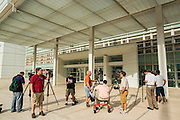 "19 JULY 2012 - PHOENIX, AZ:  The media in front of the US Courthouse in Phoenix on the first day of a class action lawsuit, Melendres v. Arpaio in Phoenix Thursday. The suit, brought by the ACLU and MALDEF in federal court against Maricopa County Sheriff Joe Arpaio, alleges a wide spread pattern of racial profiling during Arpaio's ""crime suppression sweeps"" that targeted undocumented immigrants. U.S. District Judge Murray Snow granted the case class action status opening it up to all Latinos stopped by Maricopa County Sheriff's Office deputies during the crime sweeps. The case is being heard in Judge Snow's court.  PHOTO BY JACK KURTZ"