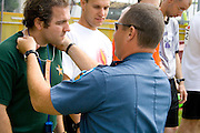 Policeman placing ribbon on athletes neck. Special Olympics U of M Bierman Athletic Complex. Minneapolis Minnesota USA