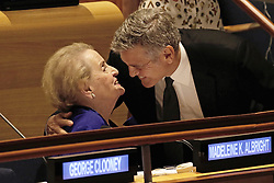 September 20, 2016 - New York, New York, United States of America - United States actor George Clooney (R) embraces former US Secretary of State Madeleine Albright at a Leaders Summit for Refugees during the United Nations 71st session of the General Debate at the United Nations General Assembly at United Nations headquarters in New York, New York, USA, 20 September 2016..Credit: Peter Foley / Pool via CNP (Credit Image: © Peter Foley/CNP via ZUMA Wire)