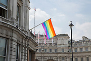 A huge rainbow flags hangs outside the Royal Bank of Scotland bank on opposite Trafalgar Square on the 5th July 2018 in London in the United Kingdom. London embraces equality ahead of Pride London Festival.