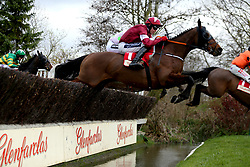 Tiger Roll ridden by jockey Keith Donoghue goes over a water jump in the Glenfarclas Chase during Ladies Day of the 2019 Cheltenham Festival at Cheltenham Racecourse.