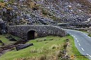 Narrow roadway over stone bridge at the Gap of Dunloe near Killarney, Ireland