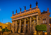 ------<br /> The Teatro Juarez is one of the most architectural stunning buildings in Guanajuato. Its main entrance is straight from ancient Rome while the flamboyant interior is oriental inspired. Teatro Juarez is regarded as one of Mexico's premier theaters. The initial construction of Teatro Juarez was started in 1872 based on the design by architect José Noriega. The theatre follows the neoclassical styling of eclecticism which was very popular within Mexico at the end of the 19th century. This design style was inspired by stories of ancient Rome and Greece and examples can be seen throughout the wondrous exterior. The rows of steps which lead up to the grand entrance with the 12 stately pillars so closely resembles the Pantheon of Rome. At the top of the roof stand 8 bronze statues from Greek mythology. The interior of the theatre was based on common European designs with four tiers of boxes and the stalls are based around a horseshoe shape. The theatre was inaugurated on the 27th of October 1903 by President Porfirio Diaz but the heyday of Teatro Juarez was a few years later between 1907 and 1910 when patrons would travel from all over the state to view the latest performances. During this period the Teatro Juarez was regarded as the most magnificent and prestigious theatre in the whole of Mexico. Since 1972 the Juarez Theater has been the focal point for the International Cervantes Festival.<br /> <br /> Guanajuato is a city and municipality in central Mexico and the capital of the state of the same name. It is part of the macroregion of Bajío. It is in a narrow valley, which makes its streets narrow and winding. Most are alleys that cars cannot pass through, and some are long sets of stairs up the mountainsides. Many of the city's thoroughfares are partially or fully underground. The historic center has numerous small plazas and colonial-era mansions, churches and civil constructions built using pink or green sandstone.
