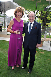 JULIA PEYTON-JONES and LORD PALUMBO at the annual Serpentine Gallery Summer Party sponsored by Canvas TV  the new global arts TV network, held at the Serpentine Gallery, Kensington Gardens, London on 9th July 2009.