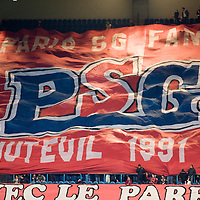 8 March 2007: Supporters of the french soccer team Paris Saint-Germain (PSG) Football Club hold banners in the stands prior to the UEFA Cup eighth-finals First Leg soccer game won 2-1 by PSG FC over SL Benfica at the Parc des Princes stadium, in Paris, France.