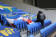 Ground staff putting put banners at Plough Lane during the EFL Sky Bet League 1 match between AFC Wimbledon and Sunderland at Plough Lane, London, United Kingdom on 16 January 2021.