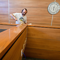 073013       Brian Leddy<br /> Daryl Costrain laquers the woodwork in a courtroom at Magistrate Court on Tuesday morning. The court is closed for the week while employees make the transition to the new building but will reopen on Monday at 8am.