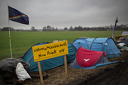 """© Licensed to London News Pictures . 24/01/2014 . Barton Moss Road , Manchester , UK . Sign reading """" Welcome to the desolate North now Frack off """" . Site of a protest camp on Barton Moss Road where anti-fracking demonstrators are based on an access road leading to an iGas fracking site as today (24th January 2014) Greater Manchester Police announce two further arrests from the ongoing protest after reporting that a security guard was threatened and assaulted on Barton Moss Road on Monday (20th January 2014) . Photo credit : Joel Goodman/LNP"""