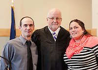 Graduates Shane Fifield and Nicole Center with Judge James M. Carroll at the Drug Recovery graduation ceremony in Laconia Circuit Court Tuesday afternoon.   (Karen Bobotas/for the Laconia Daily Sun)
