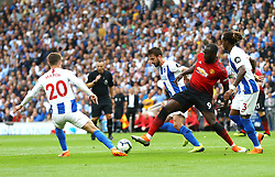 Brighton & Hove Albion's Solly March (left) and Gaetan Bong (right) battles for the ball with Manchester United's Romelu Lukaku (centre) during the Premier League match at the AMEX Stadium, Brighton.