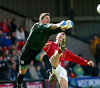 Photo: Dave Linney.<br />Walsall v Bristol City. Coca Cola League 1. 08/04/2006.Bristol's Adriano Basso(L) punches clear before   Steve Claridge nips in