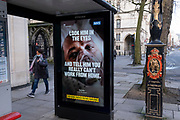 A government NHS (National Heath Service) ad at a Bus stop near the Royal Courts of Justice displays the face of a Covid patient, urging Londoners to stay at home and to socially distance, outside the Royal Courts of Justice, on 2nd February 2021, in London, England.