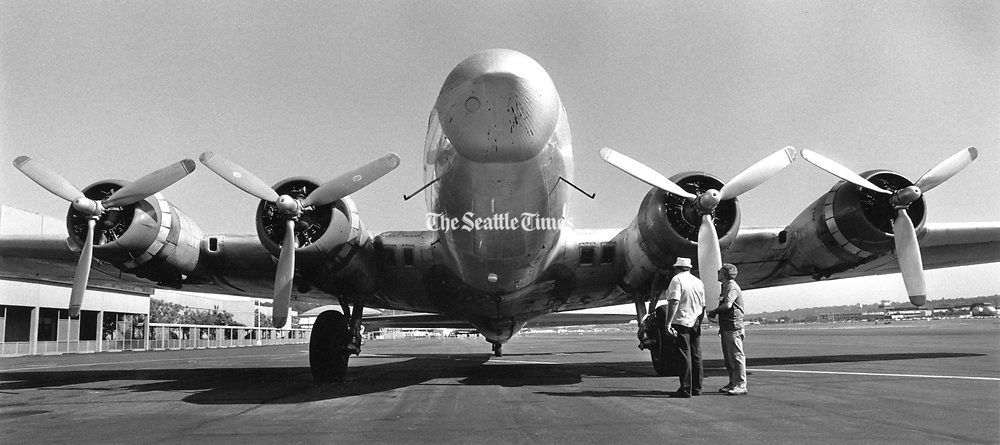 """The Flying Fortress- a Boeing-built B-17 World War II bomber- returned to Seattle and its new home as the centerpiece of the Museum of Flight. The plane, manufactured by Boeing in Seattle and one of 2,300 Model-F bombers built for service in Europe, arrived on June 20, 1985, at King County Airport after a flight from Mesa, Ariz., where it was acquired for the museum by Robert """"Swage"""" Richardson, a Ballard businessman. (Barry Wong / The Seattle Times, 1985)"""