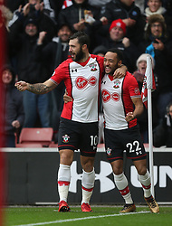 10 December 2017 Southampton : Premier League Football : Southampton v Arsenal : Charlie Austin (left) celebrates the opening Southampton goal with Nathan Redmond.<br /> (photo by Mark Leech)