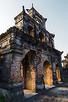Duc Duc tomb is simpler and less grandiose than other tombs in Hue, yet it is evokative for its bucolic undeveloped setting free of souvenir vendors and even ticket entrance fees.   The entrance is a triple gate made of brick.  Behind, there is a courtyard without stone statues decorated with parapets. In the middle of the surrounding wall is Huynh Oc house with its yellow tile roof.