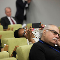 Correspondent Rebecca Theodora takes a photograph during the Closing Press Conference of The Ocean Conference at the UN in New York on June 09, 2017.