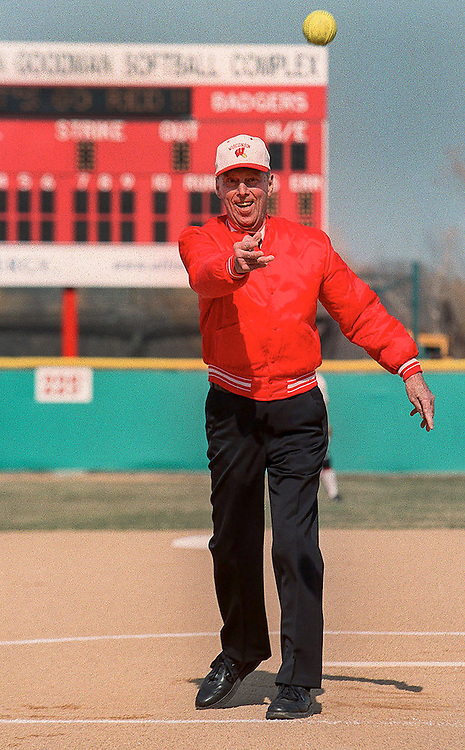 Bob Goodman throws out the ceremonial first pitch during the dedication of the Robert and Irwin Goodman Softball Complex Tuesday. (Photo © Andy Manis)